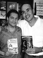 Eric and Paul proudly hold copies of each other's books.